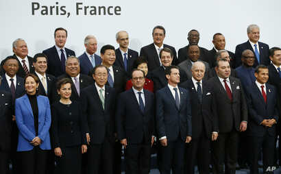 French President Francois Hollande, front center, poses with world leaders for a group photo as part of the COP21, United Nations Climate Change Conference, in Le Bourget, outside Paris, Nov. 30, 2015.