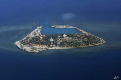 FILE - The Vietnamese-claimed Southwest Cay island in the Spratly island group is seen from a Philippine Air Force C-130 transport plane.