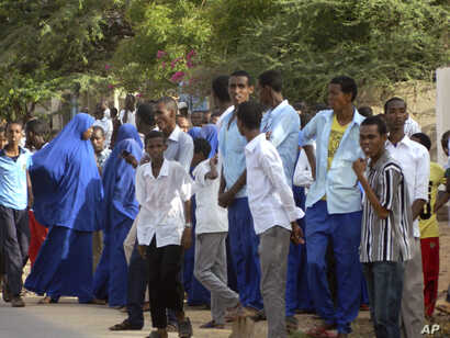 Students gather and watch from a distance outside the Garissa University College after an attack by gunmen, in Garissa, Kenya, Thursday, April 2, 2015. Gunmen attacked the university early Thursday, shooting indiscriminately in campus hostels. Police...
