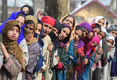 Kashmiri villagers look on during the funeral of militant commander Noor Mohammad Tantray in the Aripal village of Tral district on December 26, 2017.