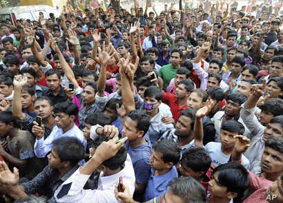 Bangladeshis protest outside a garment-factory where a fire killed more than 100 people Saturday on the outskirts of Dhaka, Bangladesh, November 26, 2012.