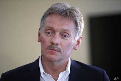 President Vladimir Putin's spokesman Dmitry Peskov speaks with The Associated Press in Moscow, April 6, 2017. Peskov, speaking days after a suspected chemical weapons attack, says Russia's support for Syrian President Bashar Assad is not unconditiona