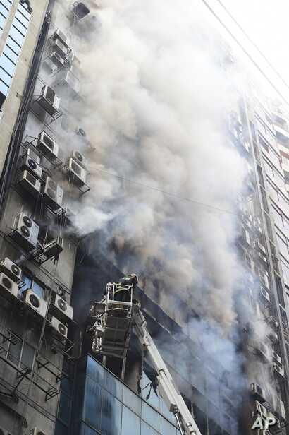 A fire in a high-rise office building in Bangladesh's capital Dhaka Thursday killed 25 people and injured dozens more, police said.