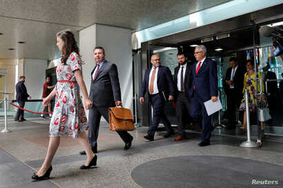 Turkish Deputy Foreign Minister Sedat Onal (2nd-L) leaves after a meeting with U.S. Deputy Secretary of State John Sullivan at State Department in Washington, U.S., Aug. 8, 2018.
