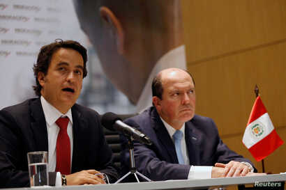 Christian Kruger, Colombia's Migration Director and Eduardo Sevilla, Peru's Migration Superintendent, speak at a news conference in Bogota, Colombia, Aug. 28, 2018.
