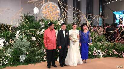 Prime Minister Hun Sen and his wife in picture with Sok Sokan, the son of the late Council of Ministers President Sok An, and Sam Ang Leakhena whose parents own Vattanac Capital on their wedding day in June. (Facebook)