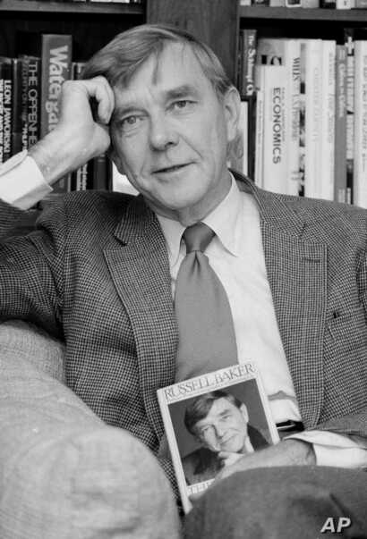 FILE - New York Times columnist and Pulitzer Prize winning author, Russell Baker, is pictured at his office at the New York Times in New York, Oct. 17, 1983.