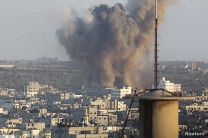 FILE - Smoke rises after an explosion in what witnesses said was an Israeli air strike in Gaza, August 20, 2014.