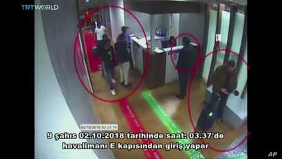 """This image taken from surveillance camera shows a still image of people inside Ataturk International Airport, Istanbul, Turkey, on Oct. 2, 2018. The text on the screen from source in Turkish reads: """"nine people enter from airport's E Gate on Oct. 2, ..."""