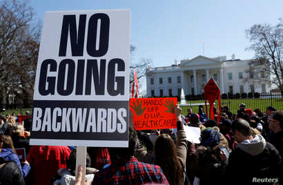 Protesters demonstrate against U.S. President Donald Trump and his plans to end Obamacare outside the White House in Washington, U.S., March 23, 2017.