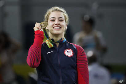 FILE - United States' Helen Louise Maroulis reacts during the winners ceremony for the women's 53-kg freestyle wrestling competition at the 2016 Summer Olympics in Rio de Janeiro, Brazil, Aug. 18, 2016.