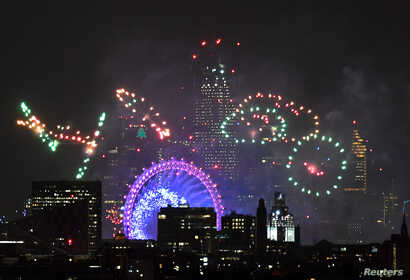 Fireworks light up the sky around the London Eye wheel to welcome the New Year in London, Britain, Jan. 1, 2019.