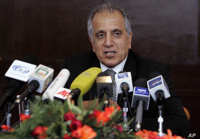 In this March 13, 2009, file photo, Zalmay Khalilzad, special adviser on reconciliation speaks during a news conference in Kabul, Afghanistan.