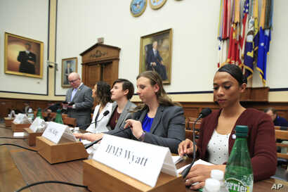 From left, transgender military members Navy Lt. Cmdr. Blake Dremann, Army Capt. Alivia Stehlik, Army Capt. Jennifer Peace, Army Staff Sgt. Patricia King and Navy Petty Officer Third Class Akira Wyatt prepare for the House Armed Services subcommittee...
