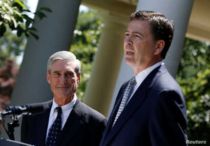 FILE - James Comey, right, a Republican who served in President George W. Bush's Justice Department, speaks alongside outgoing FBI Director Robert Mueller in the Rose Garden of the White House in Washington, June 21, 2013.