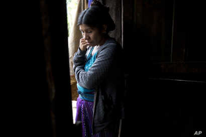 Catarina Alonzo Perez, mother of the second Guatemalan child this month to die while in U.S. custody, stands in her kitchen in Yalambojoch, Guatemala, Dec. 29, 2018.
