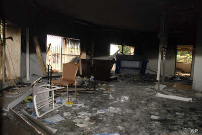 FILE - Glass, debris and overturned furniture are strewn inside a room in the gutted U.S. consulate in Benghazi, Libya, after an attack that killed four Americans, including Ambassador Chris Stevens, Sept. 12, 2012.