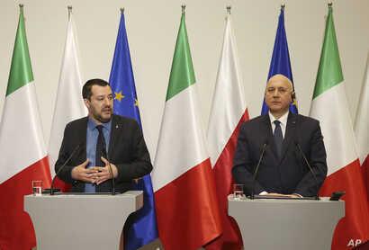 Italian Interior Minister Matteo Salvini, left, and his Polish counterpart Joachim Brudzinski, right, address the media following their talks in Warsaw, Poland, Jan. 9, 2019.