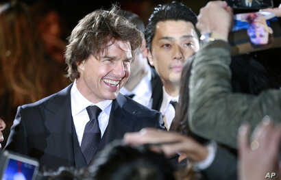 """FILE - Actor Tom Cruise smiles at fans upon his arrival for the Japan premiere of """"Jack Reacher: Never Go Back"""" in Tokyo, Nov. 9, 2016. Cruise stars in a new movie, """"The Mummy,"""" that debuted Wednesday at CinemaCon in Las Vegas."""
