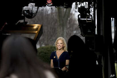 President Donald Trump's adviser Kellyanne Conway gets ready to speak on television outside the White House in Washington, D.C., Jan. 22, 2017.