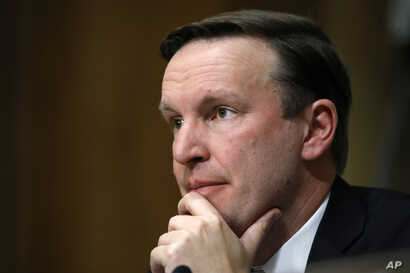 Sen. Chris Murphy, D-Conn., listens to testimony from Secretary of State-designate Mike Pompeo during a Senate Foreign Relations Committee confirmation hearing on Pompeo's nomination on Capitol Hill in Washington, April 12, 2018.