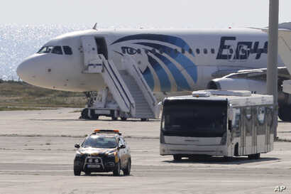 A bus carrying some passengers from the hijacked EgyptAir aircraft as it landed at Larnaca airport, March 29, 2016.