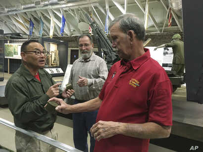 Vietnam veteran Dallas Brown, right, talks about food rations during the war with Tom Hara of the Fort Campbell Historical Foundation, at Fort Campbell, Kentucky, Oct. 27, 2017.
