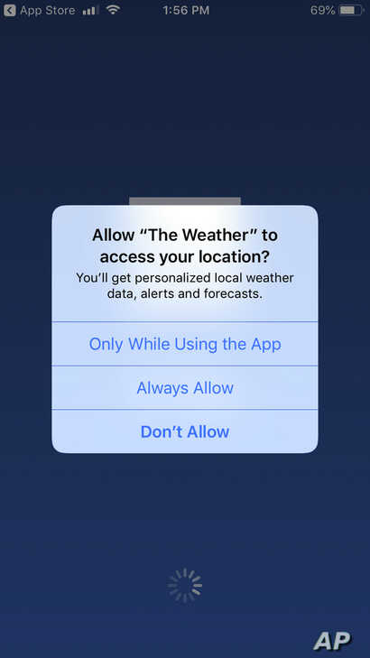 A mobile phone with The Weather Channel app location preference page is seen Jan. 4, 2019.