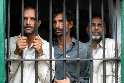 Pakistani villagers from right, Mohammad Akbar, Mohammad Ali and Liaquat Ali who are allegedly involved in the gang-rape of a woman stand behind bars at a local police station, July 7, 2005 in Chiniot, about 250 kilometers (150 miles) northwest of Mu...