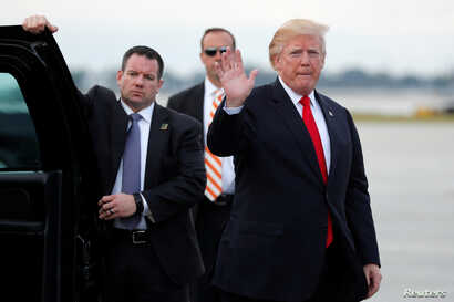 U.S. President Donald Trump arrives to board Air Force One to return to Washington at the conclusion on their holiday vacation, from Palm Beach International Airport in West Palm Beach, Florida, Jan. 1, 2018.