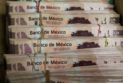 Bundles of Mexican peso banknotes are pictured at a currency exchange shop in Ciudad Juarez, Mexico, Jan. 15, 2018.
