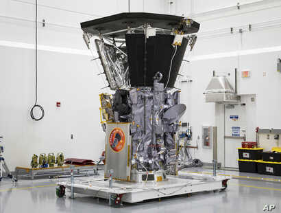 The Parker Solar Probe sits in a clean room at Astrotech Space Operations in Titusville, Fla., after the installation of its heat shield, July 6, 2018.