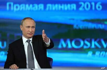 Russian President Vladimir Putin gestures as he answers a question during his annual call-in show in Moscow, April 14, 2016.