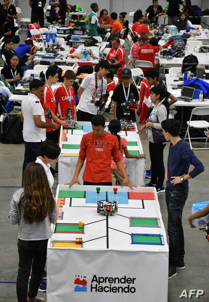 Participants from around the world take part in the World Robotics Olympiad with their miniature robots at a convention center in San Rafael, Alajuela, Costa Rica, Nov. 10, 2017.
