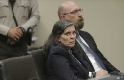 Louise Turpin and her attorney, Jeff Moore, appear in court for a conference about their case in Riverside, Calif., Feb. 23, 2018.