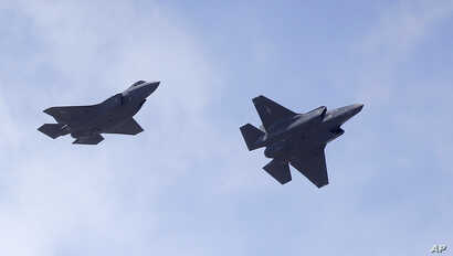 FILE - Two F-35 jets arrive at Hill Air Force Base in northern Utah, Sept. 2, 2015.