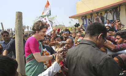 Congress party General Secretary and eastern Uttar Pradesh state in-charge Priyanka Gandhi Vadra, left, meets party supporters before undertaking a steamer ride in the River Ganges from Manaiya, 25 kilometers (15.6 miles) from Prayagraj, India, March...