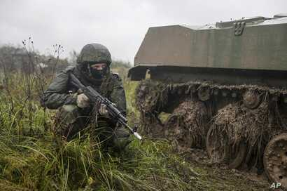 FILE - A Russian serviceman attends a military exercise at a training ground near Kaliningrad, Russia, Sept. 18, 2017.