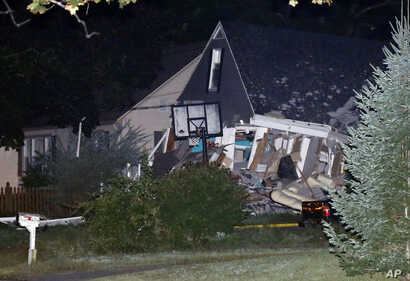 A house is destroyed, Sept. 13, 2018, in Lawrence, Mass.