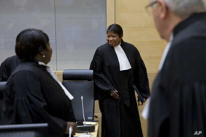 FILE - Prosecutor Fatou Bensouda (R) arrives for a hearing at the International Criminal Court in The Hague, Netherlands, Oct. 8, 2014. Bensouda announced in April she was opening a preliminary investigation into allegedly serious crimes being commit...