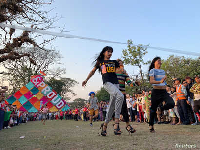 People take part in the Stiletto race of the Drag Olympics at Yangon Pride festival in Yangon, Myanmar, January 27, 2019.