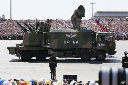 Military vehicles carry radar arrays for HQ-6A surface-to-air missile batteries during a parade commemorating the 70th anniversary of Japan's surrender during World War II held in front of Tiananmen Gate in Beijing, Sept. 3, 2015.