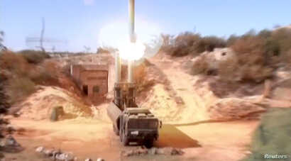 A still image taken from a video footage and released by Russia's Defence Ministry, Nov. 15, 2016, shows Russian Bastion coastal missile launchers launching Oniks missiles at an unknown location in Syria.