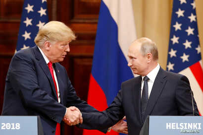 U.S. President Donald Trump and Russian President Vladimir Putin shake hands as they hold a joint news conference after their meeting in Helsinki, July 16, 2018.