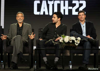 """Actor, executive producer, and director George Clooney (L-R), actor Christopher Abbott, and actor Kyle Chandler speak on a panel for the Hulu series """"Catch-22"""", during the Television Critics Association (TCA) Winter Press Tour in Pasadena, California..."""