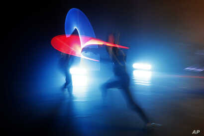 In this Feb. 10, 2019, photo, competitors battle during a national lightsaber tournament in Beaumont-sur-Oise, north of Paris. The French fencing federation has officially recognized lightsaber dueling as a competitive sport.