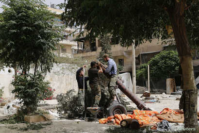 FILE - Members of the Islamist rebel group al-Nusra Front prepare a homemade mortar in the Bustan al-Qasr neighborhood of Aleppo, Syria, June 5, 2014.