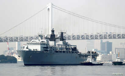 HMS Albion, the British Royal Navy flagship amphibious assault ship, arrives at Harumi Pier in Tokyo, Aug. 3, 2018.
