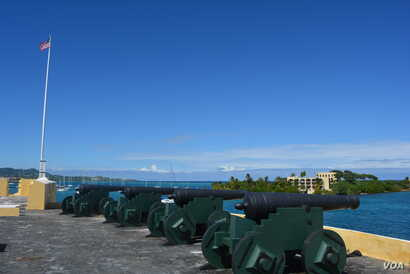 The fort's cannons overlook the island's deep water harbor.