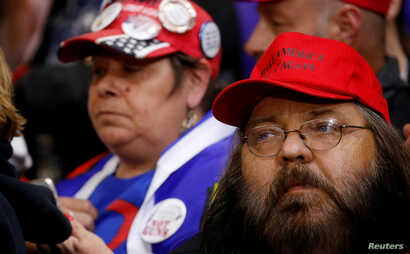 Supporters look on as President Donald Trump holds a campaign rally at Mayo Civic Center in Rochester, Minn., Oct. 4, 2018.